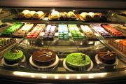 Tortes, cookies and various pastries are offered at the dessert station.