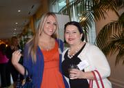 Jessica Lyons and Amanda Perry of Baker Donelson arrive to the networking session.