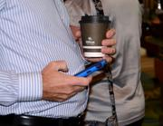 Two of the most powerful networking tools at any business event: Coffee and a smartphone
