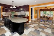 Monroe: The custom kitchen has high-end appliances and a large granite island.