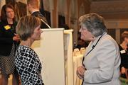 Albany Business Review Publisher Carolyn Jones, left, speaks with an attendee.