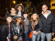 Jade Barnes (middle, with gray sweater), from Shops at Liberty Place, with her guests at East Passyunk Avenue Business Improvement District's Witch Craft Beer Crawl.