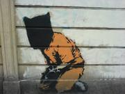Guantanamo is another recurring theme in Banksy's work.
