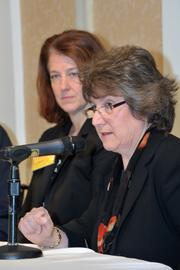 Mona Golub, of Price Chopper, foreground, was one of the Partners in Philanthropy panelists. Also on the panel, Karen Bilowith, president and CEO of the Community Foundation for the Greater Capital Region, in the background.