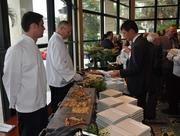 Tomo Somekawa of Nipro Diagnostics tries out the flatbread and pasta station.