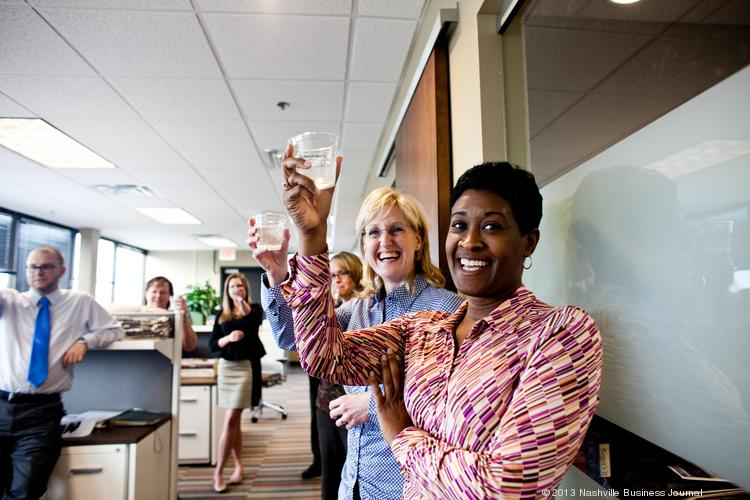 Nashville Business Journal Audience Development Director Tamara Hudson, right, Director of Advertising Amy Harris and others rise their glasses for a toast as the NBJ put the finishing touches on the Sept. 20 launch of our new design.