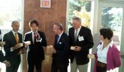 Officials at an announcement of rice bun factory Shinmei share a drink of sake at West Sacramento's city hall.