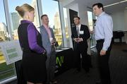 Dan Flynn (second from right) of Server Farm Realty talks with representatives at the Windstream exhibit. Windstream was a networking sponsor of the event.