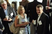 Amy Sullivan of CohnReznick and Scott Hensley (right) of CRCBR/Piedmont Properties are pictured here at the networking hour. CohnReznick was an associate sponsor of the event, while CRCBR was an industry partner.
