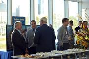 Guests and sponsors mingle prior to the start of CREQ Live.