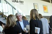Gene Bodycott of New Forum talks with fellow attendees at CREQ Live.