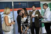 Rebecca Herron (center) of Summit Engineering chats with Amy Sullivan of CohnReznick, associate sponsor of the event.