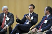 Ben Rojahn (center), vice president at CBRE, responds to a question. At left is Brian Noonan of Peak 10;  Vali Sorell of Syska Hennessy Group is at right.