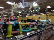 The baby aisle contains more than formula and diapers. Shoppers can find activity centers, car seats and strollers.