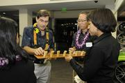 Tad Bowers, executive vice president marketing and business development at American Savings Bank, samples an appetizer at a reception for the the Best Doctors 2014 Hawaii list at BMW of Honolulu.