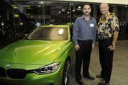 From left, Tim Palms of BMW and Bob Charlet, publisher of Pacific Business News.