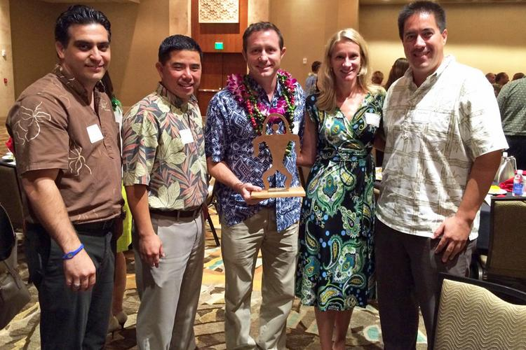 From left, Israel Avilla and Aaron Kanemaru of Bank of Hawaii, Island Olive Oil Co. owner Dana Bergeman, Alyssa Goodman, and Island Olive Oil Co. Manager Drake Hano.