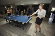 Kaitlyn Herzog of Sosh plays a game of table tennis.