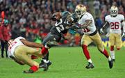 Jaguars running back Maurice Jones-Drew is tackled by Donte Whitner of the 49ers.