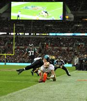 San Francisco 49ers quarterback Colin Kaepernick sneaks in for a touchdown.