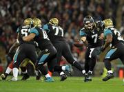 Jaguars quarterback Chad Henne hands the ball off to Maurice Jones-Drew Sunday.