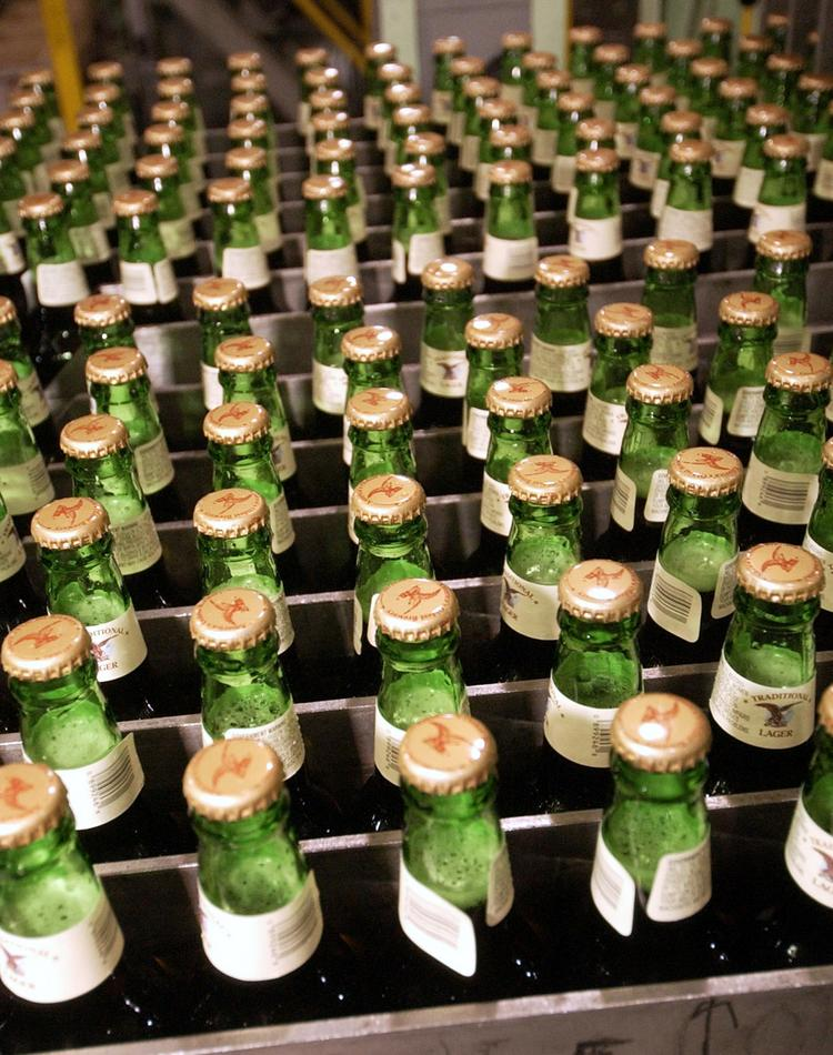 Full bottles of lager await to be loaded into cases at the Yuengling brewery in Pottsville, Pa.