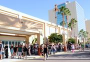 Hoards of the living lined up around the hotel convention center to celebrate the dead.