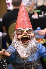 Travelocity gnome obviously roamed a little too far. Actually it's one of a series of zombie gnome statue by Gnombies.com.