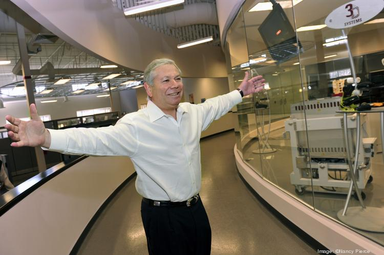 Avi Reichental, CEO of 3D Systems, gestures in the headquarters building in Rock Hill.