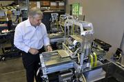 Reichental looks over a ProJet 3000 Series 3D printer.