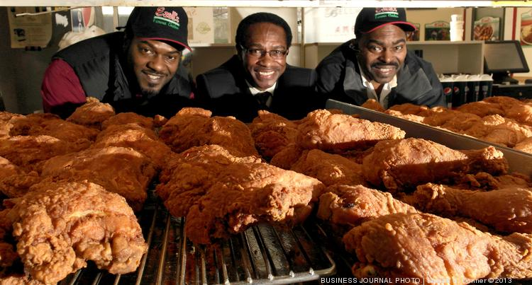 Ezell's Famous Chicken is run with the help of three brothers, from left, Darnell Rudd, Lewis Rudd (president and CEO) and Wayne Rudd (general manager). The chain, which started in this Central District spot, is opening franchises in Rainier Valley, Mill Creek, and later as far away as Dubai.