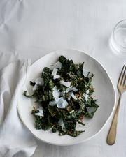 True Food's tuscan kale salad has lemon parmesan and bread crumbs.