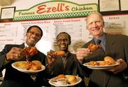 """From left, Lewis Rudd, president and CEO of Ezell's Famous Chicken; Rashid Mohamed, the chain's president of international franchises, who plans to expand later this year to Dubai and possibly Nairobi, Kenya; and Dennis Waldron, president of the franchise arm of Ezell's. Mohamed's connection to Ezell's goes back decades, to his days as a University of Washington student: """"I became hooked on that chicken."""""""