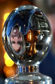 Ian G.J. MacNeil, founder of Glass Distillery, reflected in the glass stopper of his signature Glass Vodka.