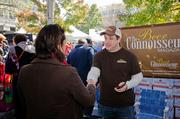 A representative from The Beer Connoisseur Magazine talks with a festival attendee.
