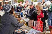 Festival attendees receive tastes.