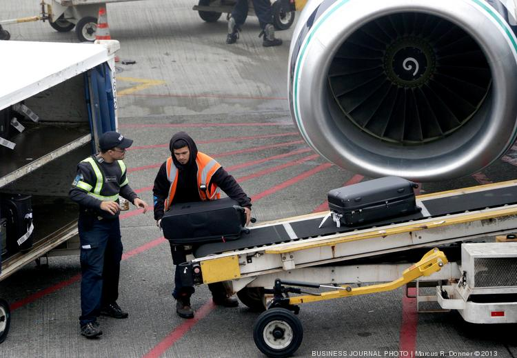 Baggage handlers at Seattle-Tacoma International Airport are unaffected by the SeaTac city $15 minimum wage law, but activists and many political leaders are pushing the port to change that.