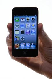 The new Apple Inc. iPod Touch is displayed during a recent Apple product unveiling. It is Apple's third most popular product with consumers in terms of sales as of the first quarter.
