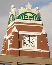 The clock atop the Starbucks Corp. headquarters keeps the time handy for Mike Tjaarda, engineer, BNSF Railway (not pictured), who works in the nearby railyard. Sixty trains a day move on BNSF's main line in Sodo.