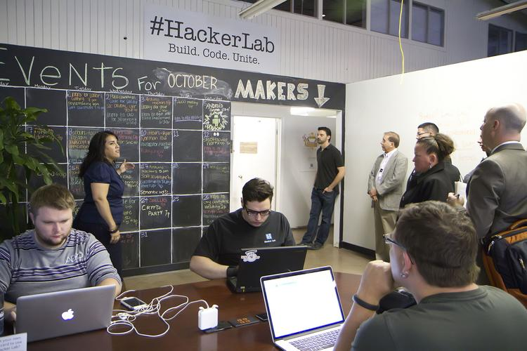 Hacker Lab cofounder Gina Lujan gives a tour during a recent internal study mission.
