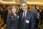 Karen Abraham, senior vice president of Blue Cross Blue Shield of Arizona, was honored as one of the Phoenix Business Journal's 2013 Outstanding CFOs. Also pictured is Ronald Butler of Ernst & Young LLP, who attending the Oct. 28 luncheon.