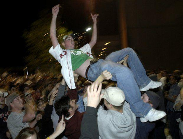 UMass is hoping to avoid any large scale melee like this pictured here in 2004 when the Boston Red Sox ended an 86-year-old drought with a World Series win. The university is warning students about fan behavior and holding parties for students to gather.