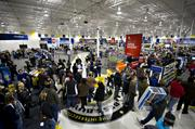 Shoppers walk through a Best Buy Co. store in Peoria, Illinois, U.S., on Friday, Nov. 23, 2012.