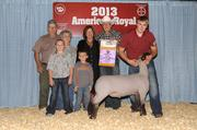 The winners of the Grand Champion Market Lamb, including Bryan and Nancy Beaver, and representatives of Flat Tail Ranch, pose with the lamb, which they paid $60,000 to acquire at the American Royal's Junior Premium Livestock Auction.