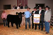 The winners of the Reserve Grand Champion Steer, including representatives of the Kemper Foundation and UMB Financial Corp., pose with the steer, which they paid a record $56,000 to acquire at the American Royal's Junior Premium Livestock Auction.