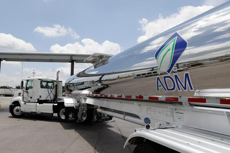 ADM's adjusted earnings and revenue fell for its third quarter.
