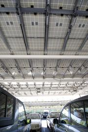 Solar panels double as a roof covering parking spaces for employees.