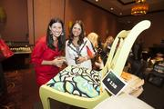 (From left) Mindy LeBeau of Marcus Investments and Kate Grimshaw of Four Points Sheraton Milwaukee look over an auction item.