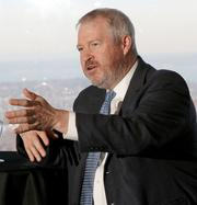 Mayor Mike McGinn defends his record at a mayoral candidates forum held by The 40, the PSBJ 40 under 40 alumni group.