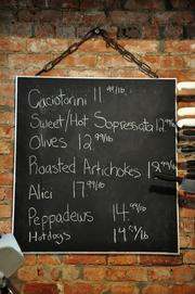 The deli board with the day's specials at The Grocery at 211 Broadway in downtown Troy, NY